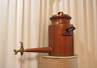 ancient copper teapot on stand